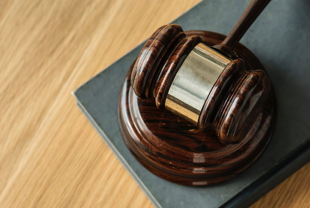 Image of a gavel resting on tabletop.
